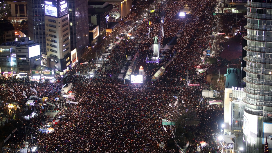 Protesters gather and occupy major streets in the city center for a rally against South Korean President Park Geun-hye in Seoul.