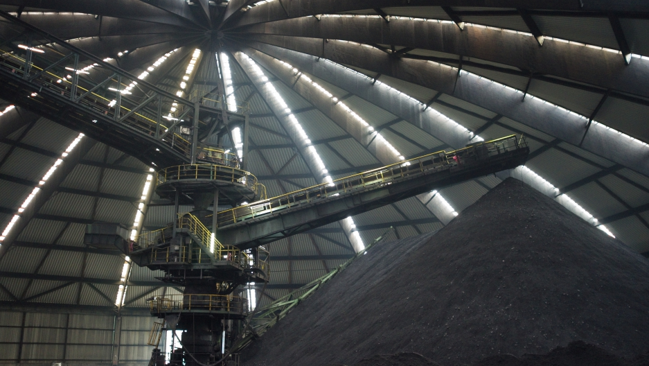 A hill of coal sits under a shelter at the Prosper-Haniel coal mine. The mine is closing after 150 years.