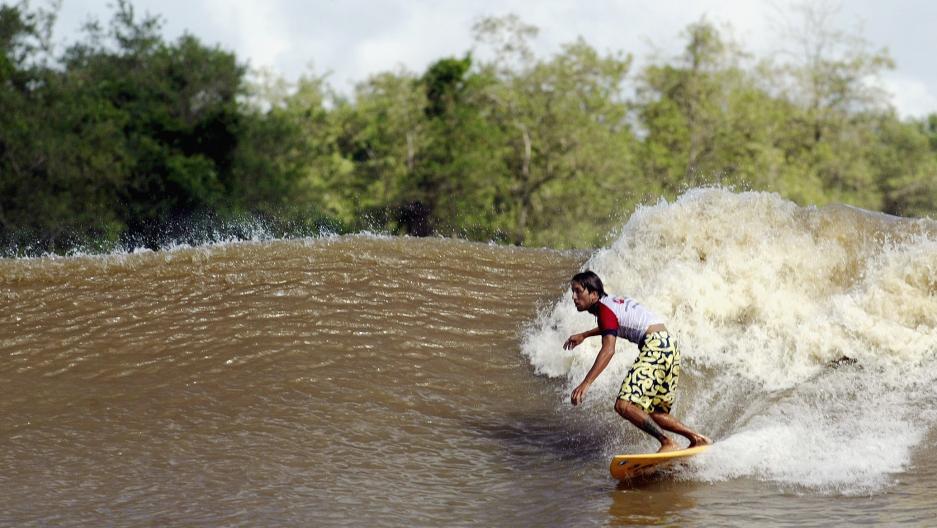 Surfer on a river wave