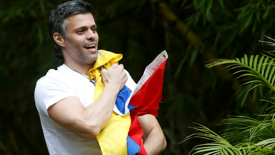 Venezuela's opposition leader Leopoldo López, who has been granted house arrest after more than three years in jail, salutes supporters, in Caracas, Venezuela