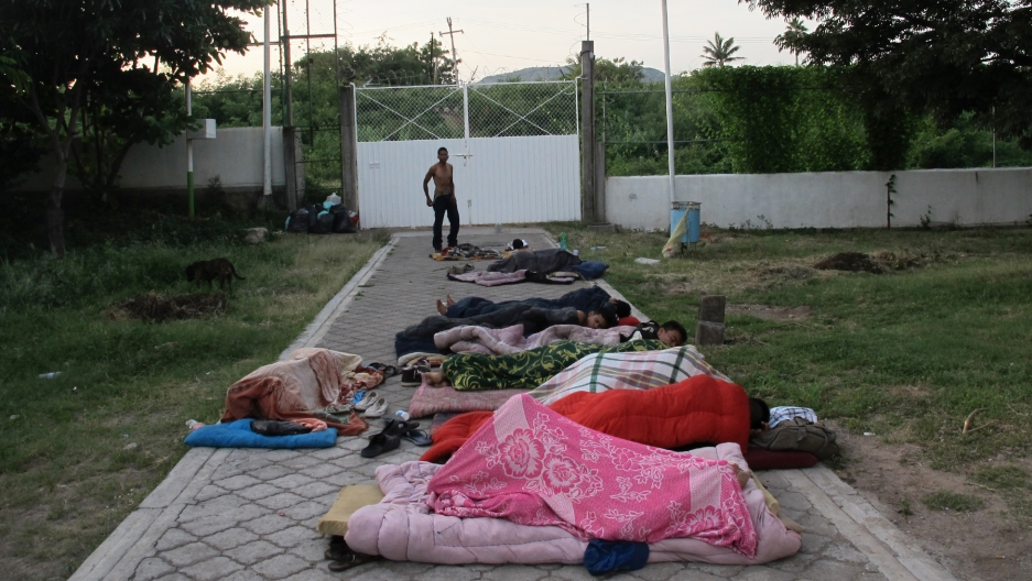 Migrants sleep on the ground at dawn at the Hermanos en el Camino shelter in Ixtepec, Oaxaca. The buildings here are too damaged by the recent earthquakes to enter.