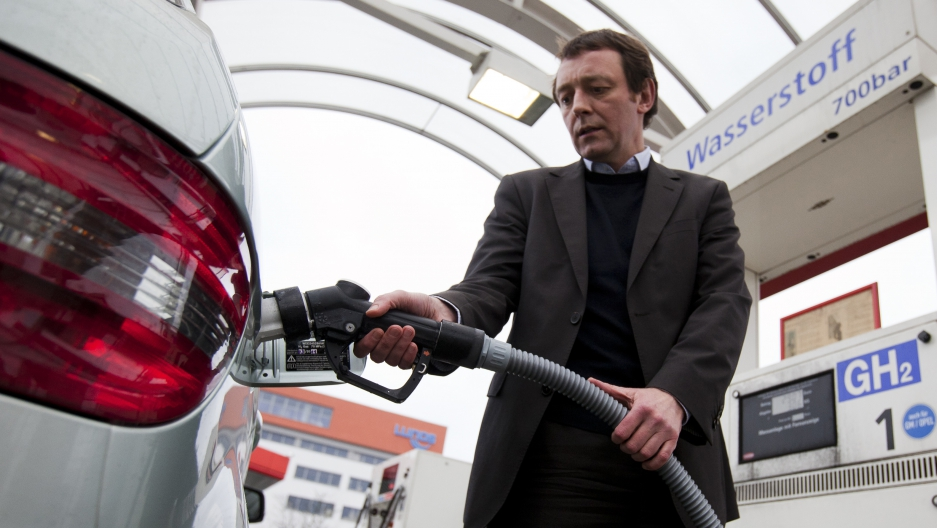 Lutz Wiese of Vattenfall power company refuels a hydrogen-powered Mercedes at a filling station in Berlin. Vatenfall is a partner in the world's first direct wind-hydrogen power plant, in northern Germany. Using wind-generated electricity to create hydrog