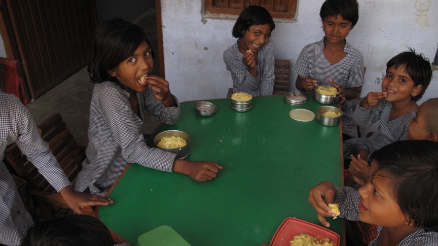 Girls eating their lunch at a government school in Bawani Khera village, in south central Haryana.