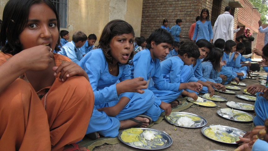 At a government school in Paposa, Haryana, children devour kadhi and rice.