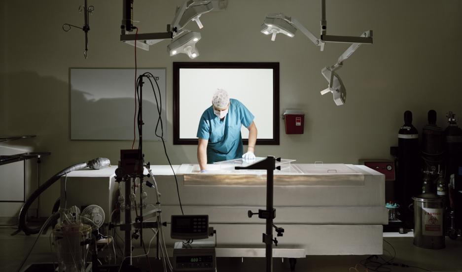 Matthew Sullivan working on a prototype operating table   Suspended Animation, Boytan Beach, Florida, USA 2010