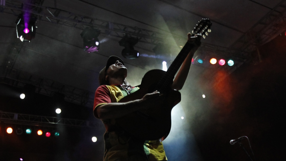 Singer Manu Chao performs during a free concert in Caracas, Venezuela on March 23, 2012.