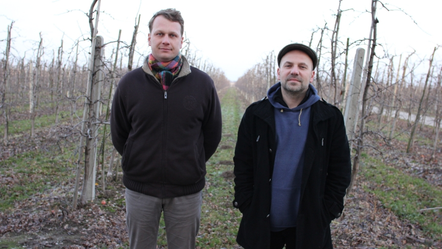 Meet two of Poland's newest commercial cider producers -- Marcin Hermanowicz (left) and Tomek Porowski. They're in an apple orchard in Ignacow, Poland.