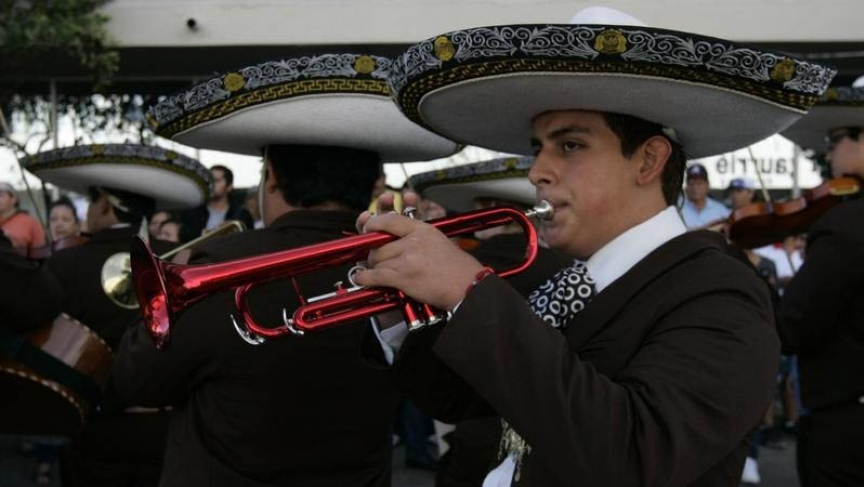 A mariachi plays a red trumpet during the International Mariachi Parade in Guadalajara September 2, 2012.