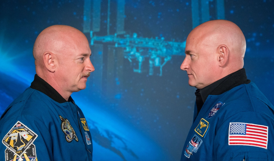 Former astronaut Mark Kelly, left, stands across from his brother, Scott Kelly, the current commander of the International Space Station.