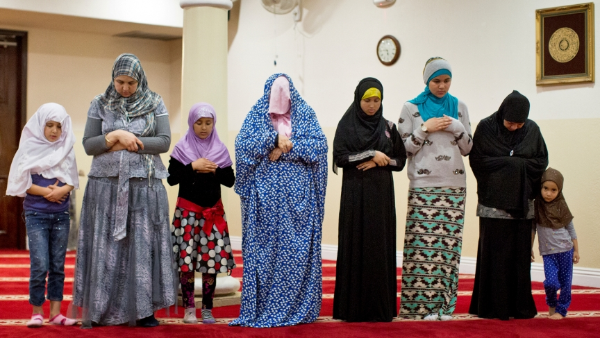 Women take part in the Maghrib prayer just after sunset at 5:34 p.m. at West Coast Islamic Society in Anaheim on Feb. 12. The prayer is the fourth of five daily prayers.