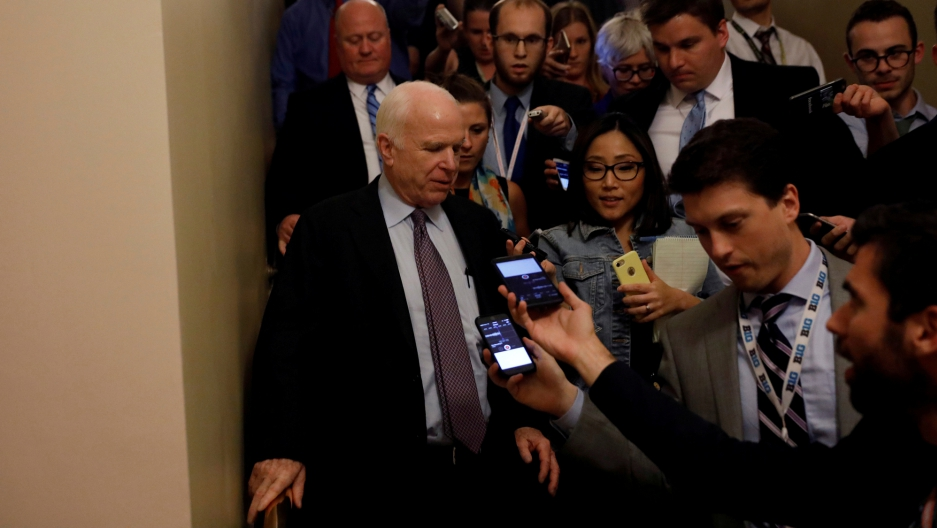 """Senator John McCain speaks with reporters after voting against the """"skinny repeal"""" health care bill on Capitol Hill in Washington, July 28, 2017."""