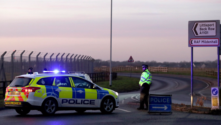 British police stand guard at the entrance to the US Air Force base at RAF Mildenhall, Suffolk, Britain, Dec. 18, 2017.