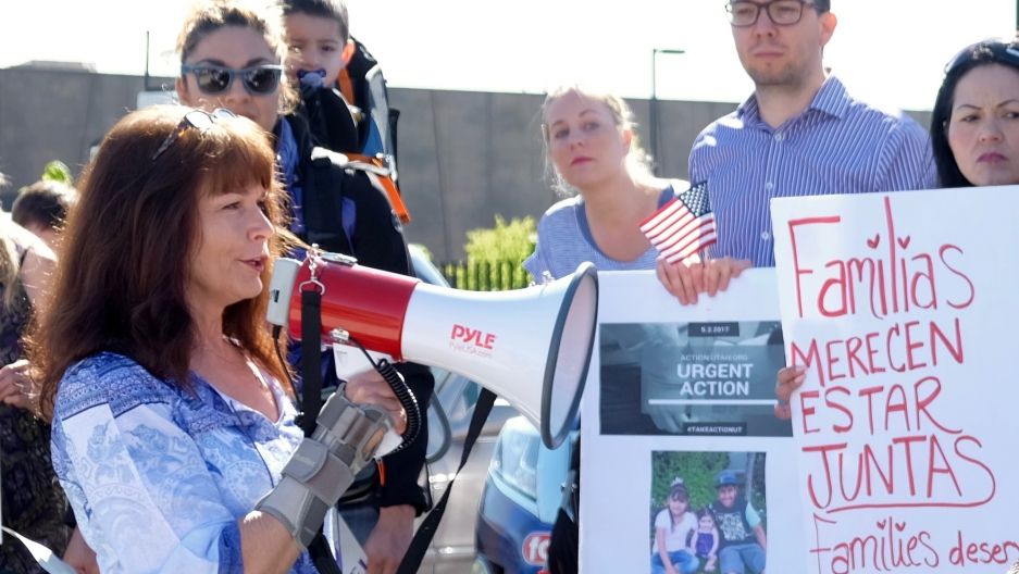 Sharlee Mullins Glenn speaks to demonstrators outside the Office of Homeland Security in West Valley City, Utah in May.