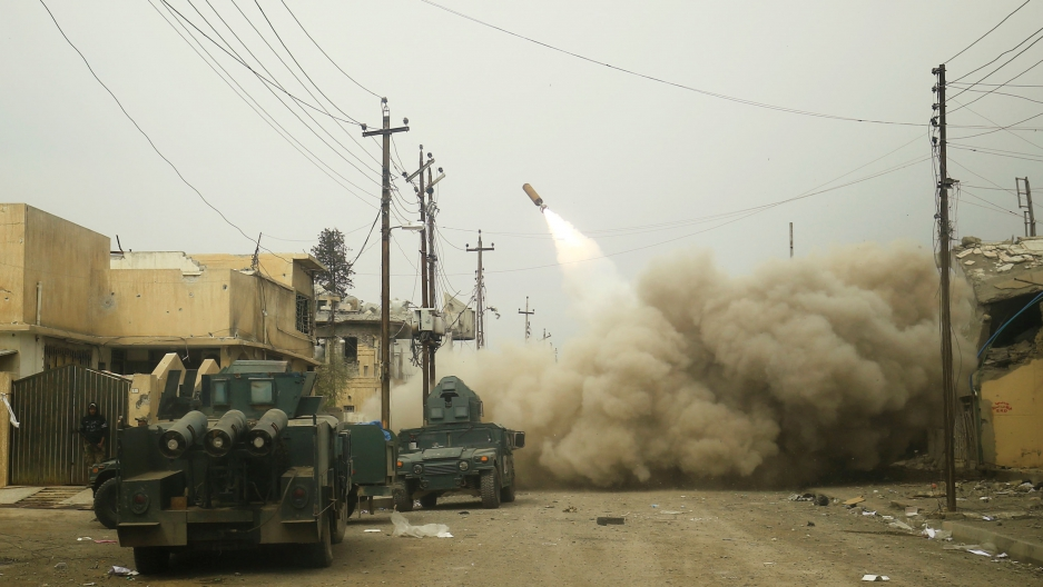 Iraqi rapid response members fire a missile against ISIS militants in Mosul, Iraq, on March 11.