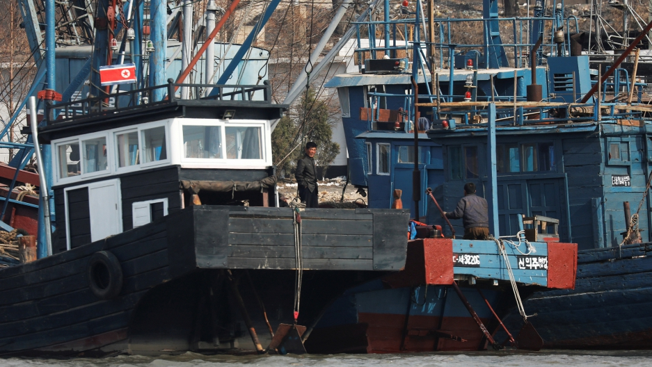 People work on boats at the port near the North Korean town of Sinuiju.