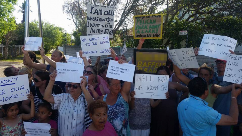 Residents at Naruna Estates say they're being forced out of their homes in an echo of an apartheid-era policy. The government says not at all -- they're just not paying their rent.