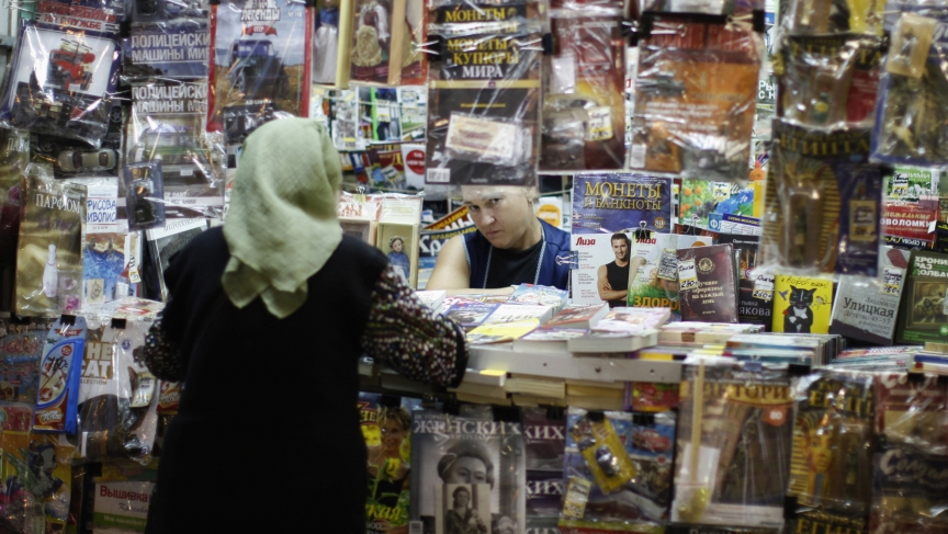 A woman works at a news-stand in the Moscow metro.