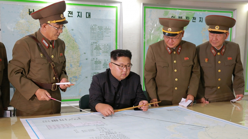 North Korean leader Kim Jong-un with military officials in an unknown location in an undated photo released by North Korea's Korean Central News Agency on August 15, 2017.