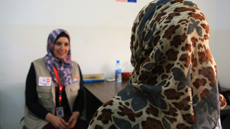 After Noor (right) fled Syria with her family, her husband began to be abusive. She now receives counseling and health services at this women's center in Jordan.