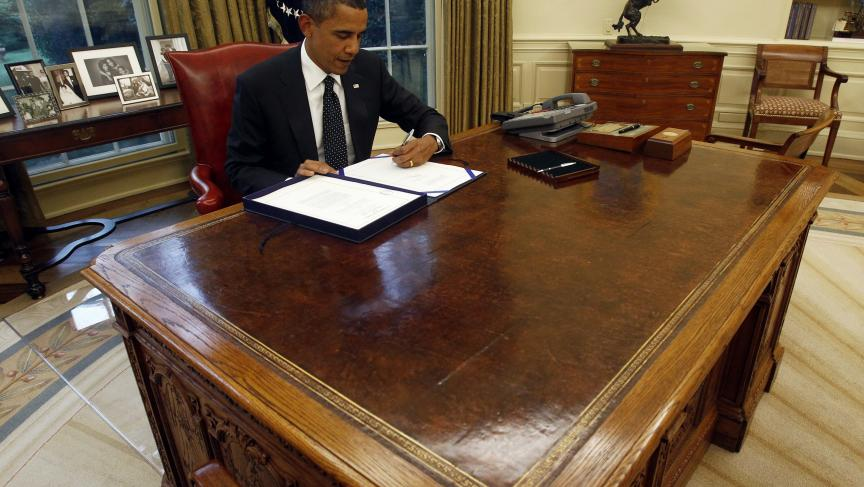 obama oval office desk. President Barack Obama At His Desk In The Oval Office White House.