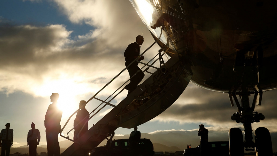 US President Barack Obama boards Air Force One after a refueling stop in Lajes Air Base in the Azores, Portugal, on his way to Peru.