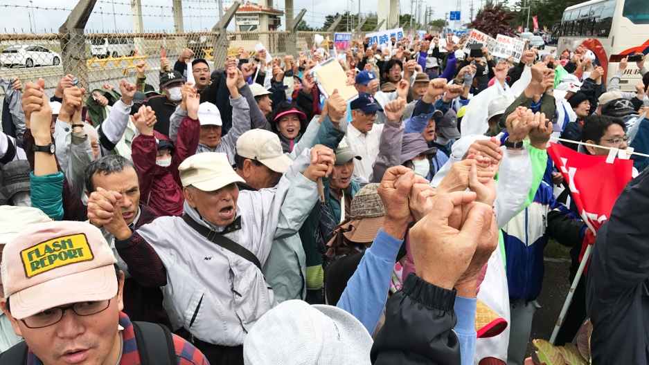 Protesters demonstrate outside a US Marine base on Okinawa. The US plans to greatly expand the base in the rural fishing village of Henoko.