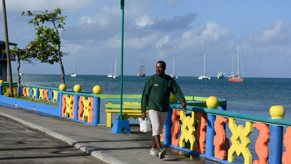 A man walks along the coast of Old Providence.