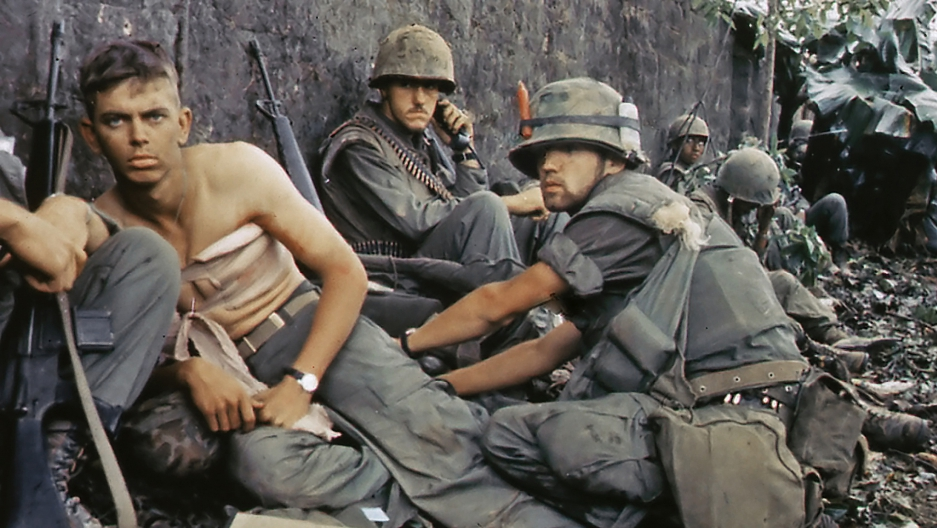 A corpsman treats a wounded Marine in the city of Hue, Vietnam, in June 1968.