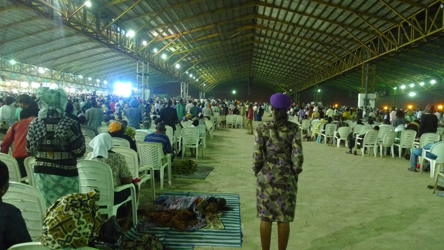 Under an open-air pavilion built to seat a million people, children sleep on mats spread out on the cobblestones while their parents enter their 6th consecutive hour of worship.