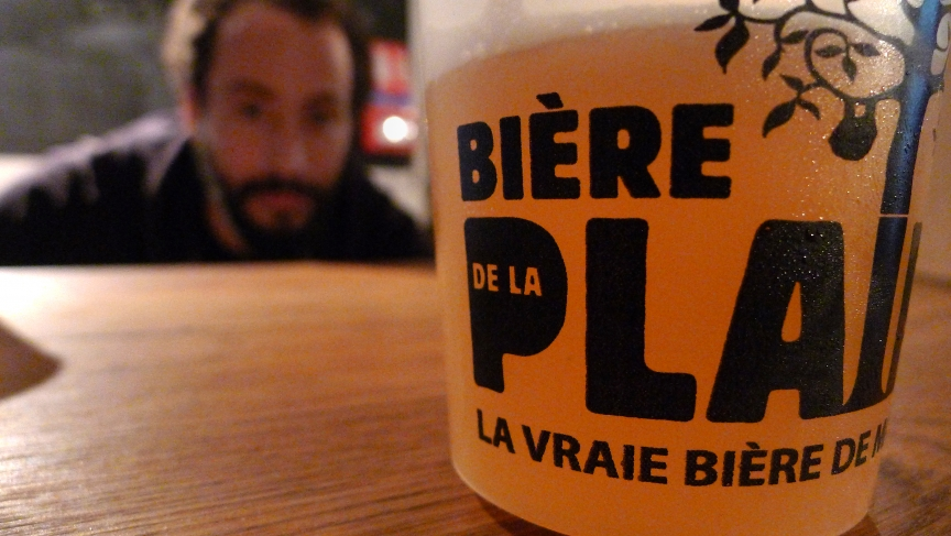Salem Haji, co-owner of one of the few microbreweries in France, inspects his latest blonde IPA at his brewery Biere de la Plaine in downtown Marseille.