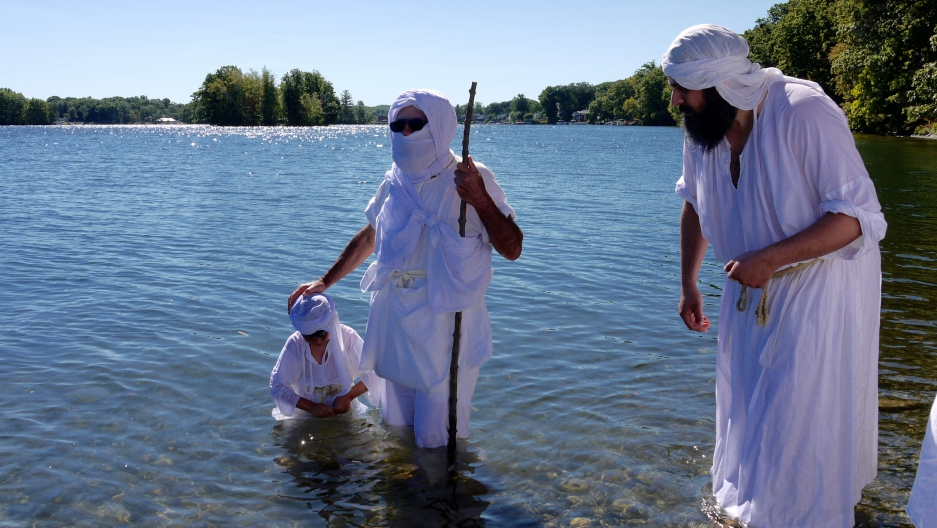 Sheikh Salah (center) is baptizing one of several dozen Mandaeans at Lake Quinsigamond in Worcester, Massachusetts, on Sept. 25, 2016.