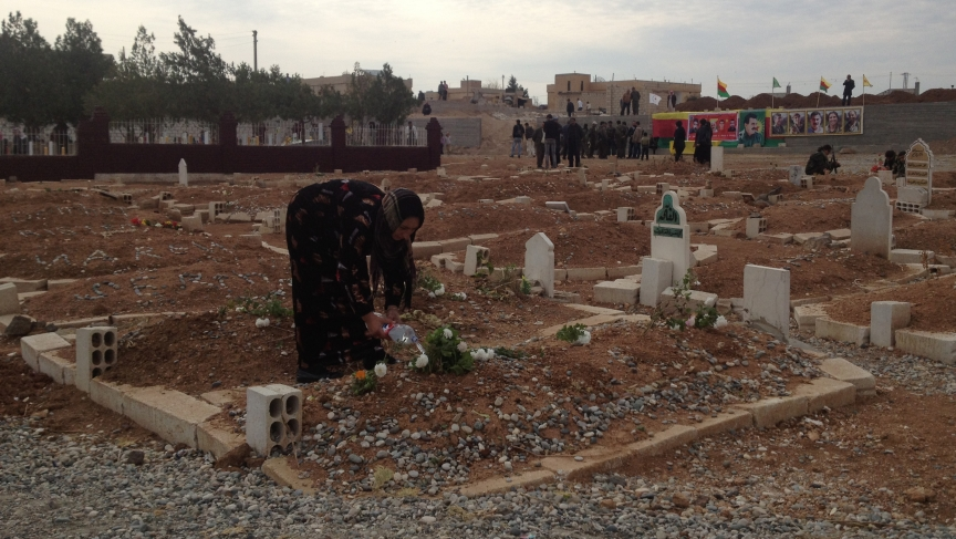 "Kurds call it the ""martyr cemetery."" Dozens of freshly-covered graves have stretched its boundaries."