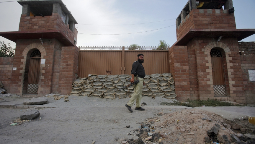 A police officer walks past Central Jail in Peshawar where Pakistani doctor Shakil Afridi now sits. Afridi was arrested in May 2011 for helping the CIA find Osama bin Laden.