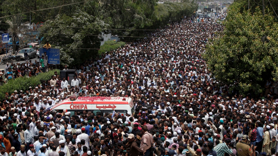 Thousands of people attend the funeral procession of Amjad Sabri, killed when unidentified gunmen open fire on his car in Karachi, Pakistan.