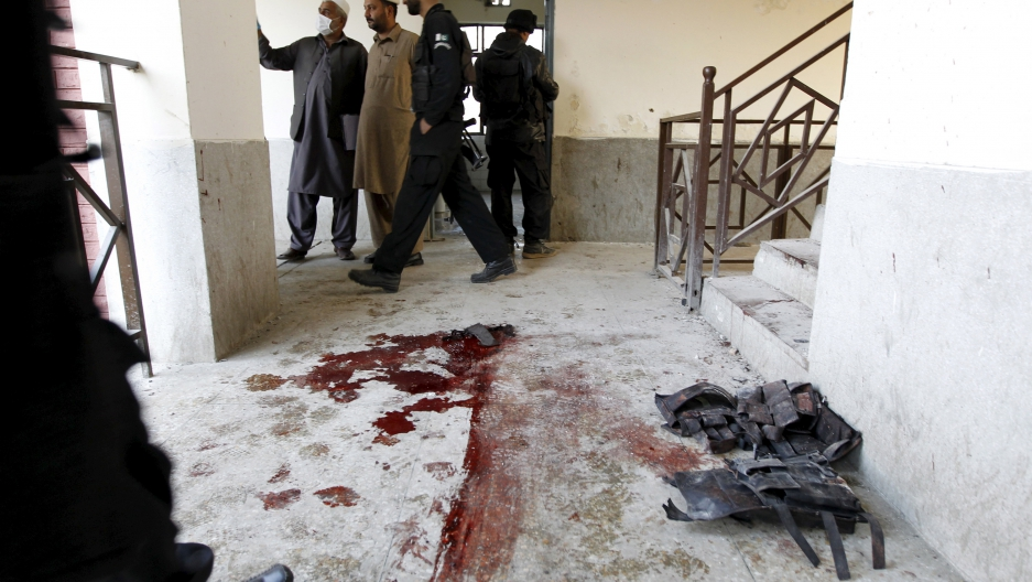 Blood stains and flak jackets used by attackers remain in the hallway of a dormitory where a militant attack took place at Bacha Khan University in Charsadda, Pakistan on January 20, 2016.
