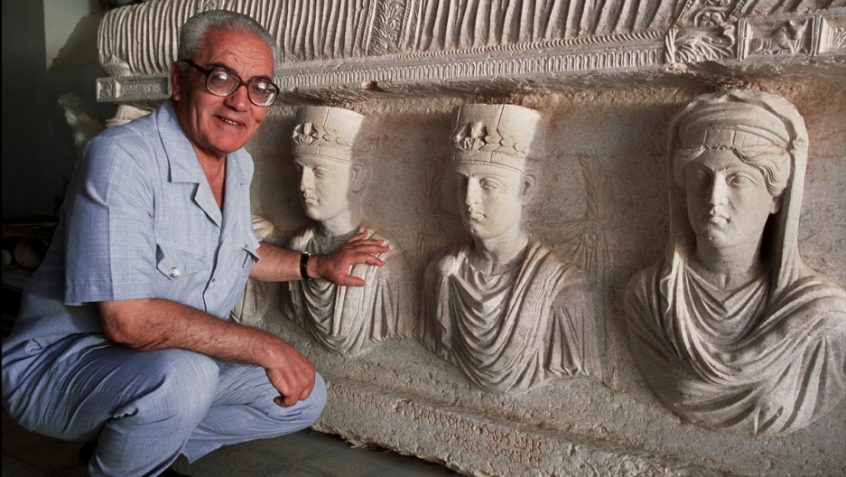 Khaled al-Asaad, the director of Antiquities and Museum in Palmyra, in front of a rare sarcophagus in Palmyra.