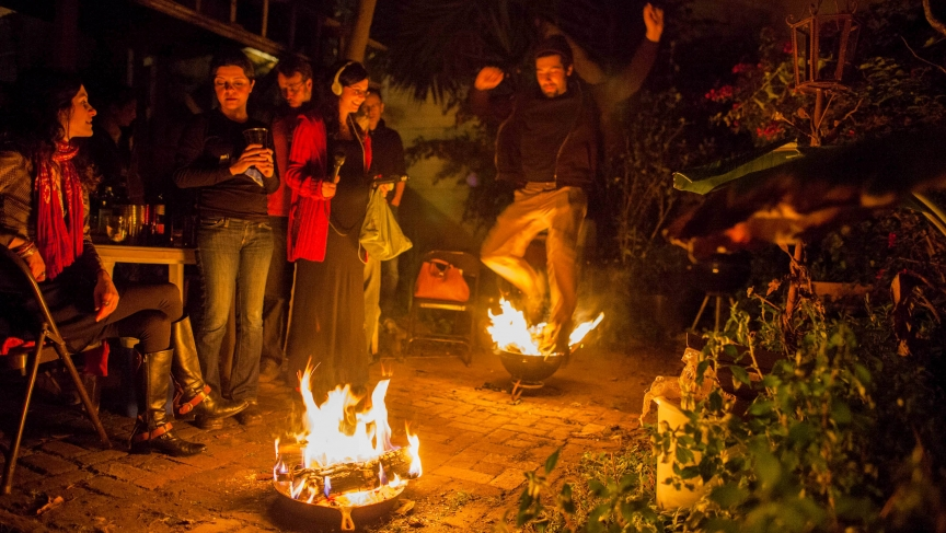 The reporter, Shuka Kalantari, records the sounds of a Persian New Year's celebration at her friend's home. Jumping over a small fire is a symbolic gesture to start a fresh new year.