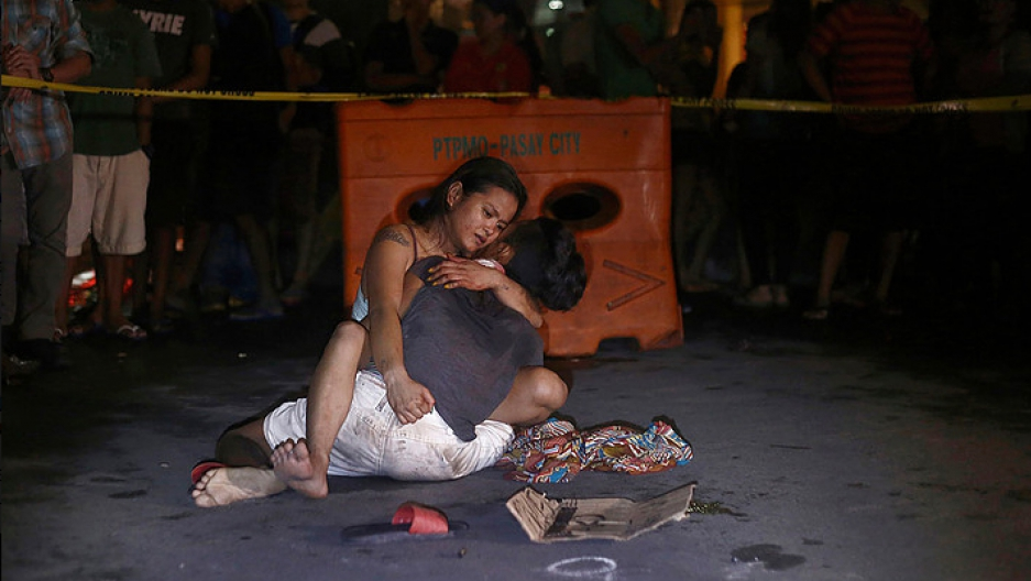 Jennelyn Olayres hold her husband's dead body, Michael Siaron, an alleged drug pusher killed by unidentified gunman in Pasay City south of Manila.