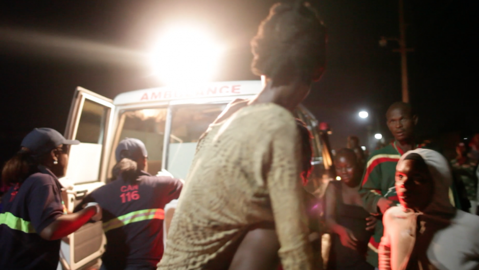 Paramedics Natasha and Beatrice pick up a woman with advanced AIDS from a slum on the outskirts of Port-au-Prince.