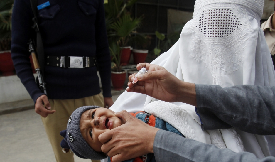 A girl cries before receiving polio vaccine drops at a government children's hospital in Peshawar on March 3, 2015. Pakistan authorities have arrested hundreds of parents who refuse to vaccinate their children against polio.