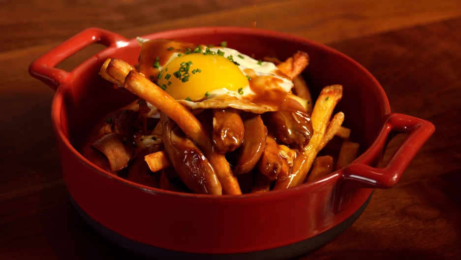The poutine at the Public House at the Venetian Hotel in Las Vegas: fries topped with duck confit, stout gravy, cheese curd and a fried egg.