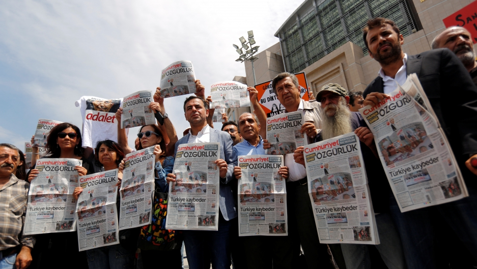 Press freedom activists hold copies of the opposition newspaper Cumhuriyet during a demonstration in solidarity with the jailed members of the newspaper outside a courthouse, in Istanbul, Turkey, July 28, 2017.