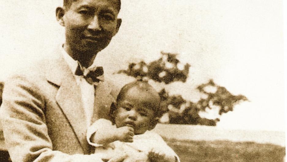 Prince Mahidol of Thailand holding the future King Bhumibol Adulyadej