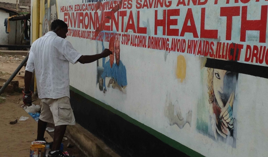 "At Redemption Hospital in Liberia, health workers screen patients for Ebola at the entrance to the facility, cleaning them off with a chlorine solution, taking their temperature and asking a series of questions. ""At our hospital we have tried to create a"