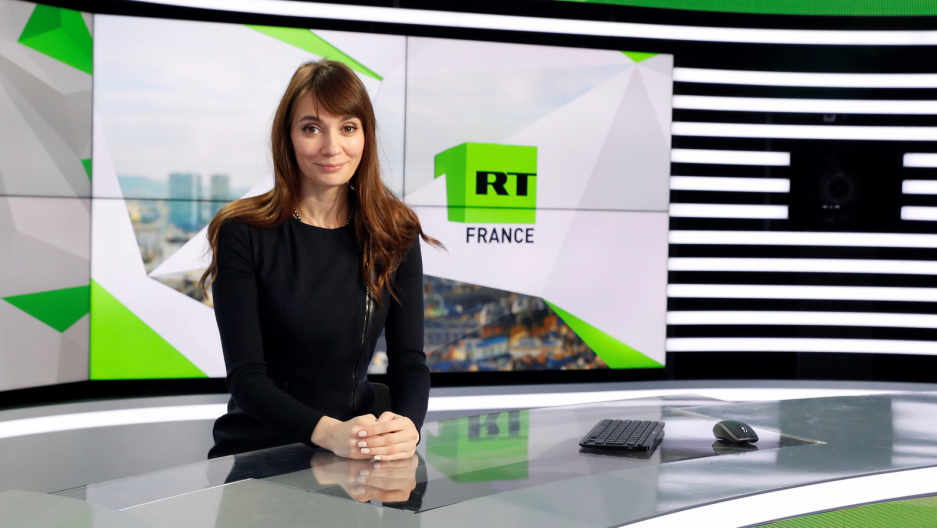 """Xenia Fedorova, chief executive of RT France, of the Russian state broadcaster RT, formerly known as """"Russia Today,"""" poses during a visit to their news studio in Boulogne-Billancourt, near Paris, France, Dec. 18, 2017."""