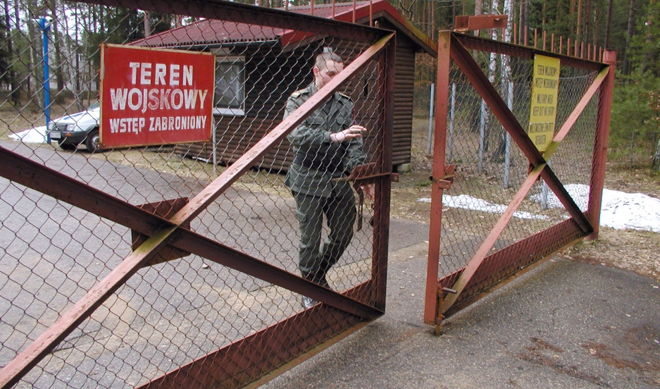 A guard shuts the gate to the airport in Szymany, Poland, in 2005. Polish media said the airport was identified by Human Rights Watch as a potential site of alleged CIA prisons used to interrogate al-Qaeda captives.