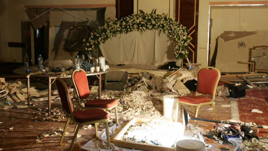 Debris lays strewn on the floor of a room being used by a wedding party following a bomb blast in the Radisson SAS hotel in Amman, November 10, 2005.