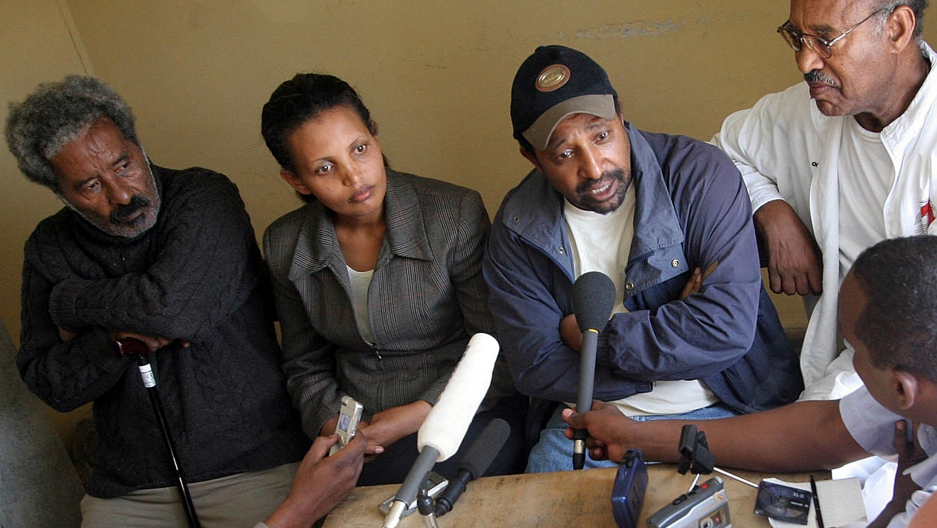 Berhanu Nega (in baseball cap), with other opposition leaders, speaking to reporters in Addis Ababa in 2005 after elections won by his party were annulled by the regime.