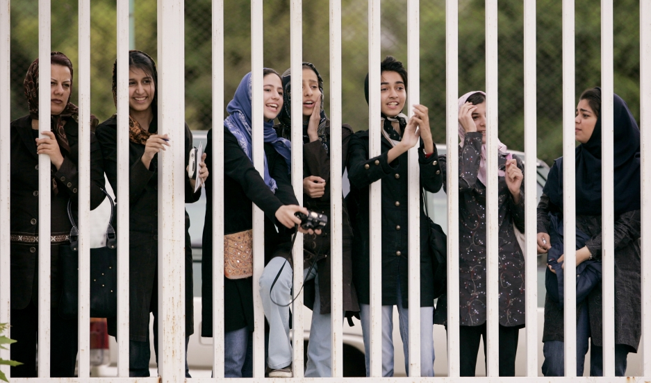 Iranian women watch Iran's national soccer team conduct a training session ahead of the 2006 World Cup.