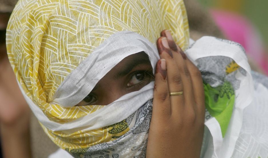 A woman prisoner waits for her release orders inside a jail in Karachi, Pakistan, July 13, 2006.